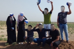 A beautiful photo of one of our teams celebrating after finishing the fieldwork of their city in one of Iraqi rural areas.